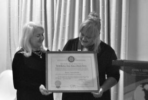 Pesident Ann Bricknell being presented with the original 1960 Club Charter by Past President Alma Maxwell in June 2016